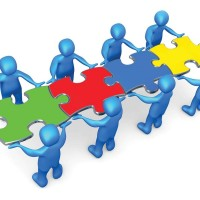 "Royalty-free 3d computer generated clipart picture image of a team of 8 blue people holding up connected pieces to a colorful puzzle that spells out ""team,"" symbolizing excellent teamwork, success and link exchanging."